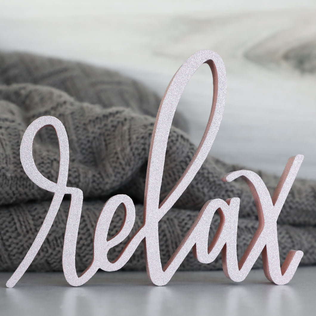 hand-lettered Relax sign