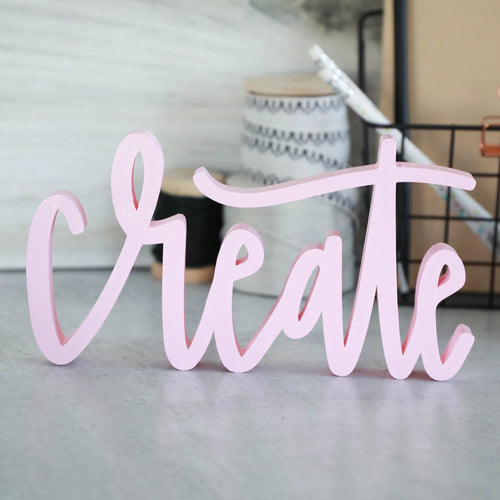 hand-lettered 'create' sign