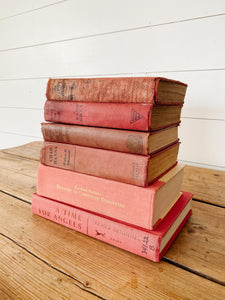 collection of pink/aged red books
