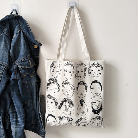 The Many Faces Tote Bag
