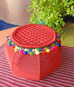 red-bamboo-pouffe-with-colourful-pompoms