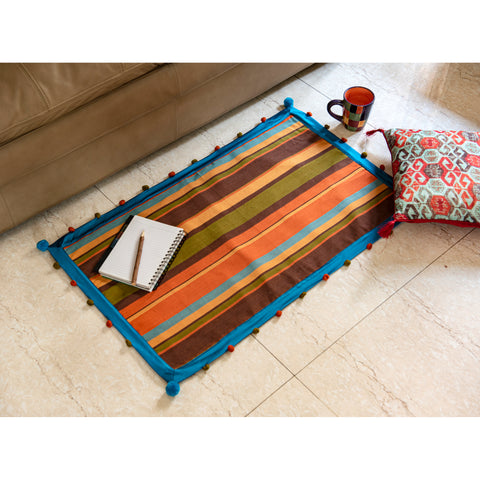 colourful-rug-with-pom-poms
