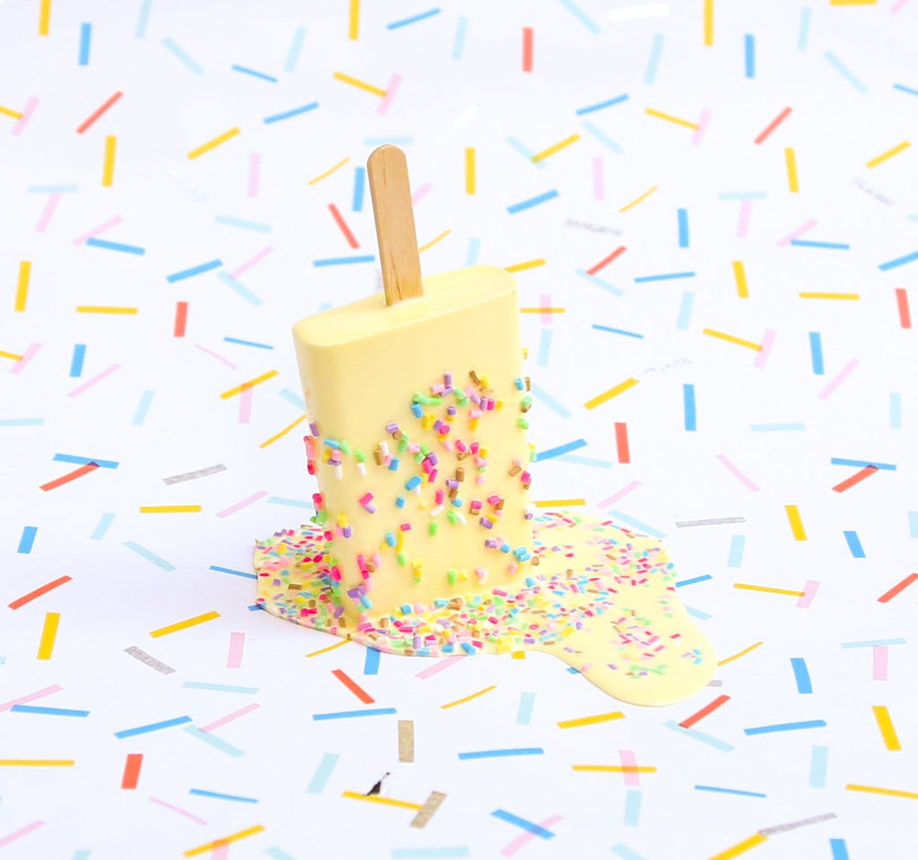 Yellow sprinkle popsicle sculpture by Betsy Enzensberger