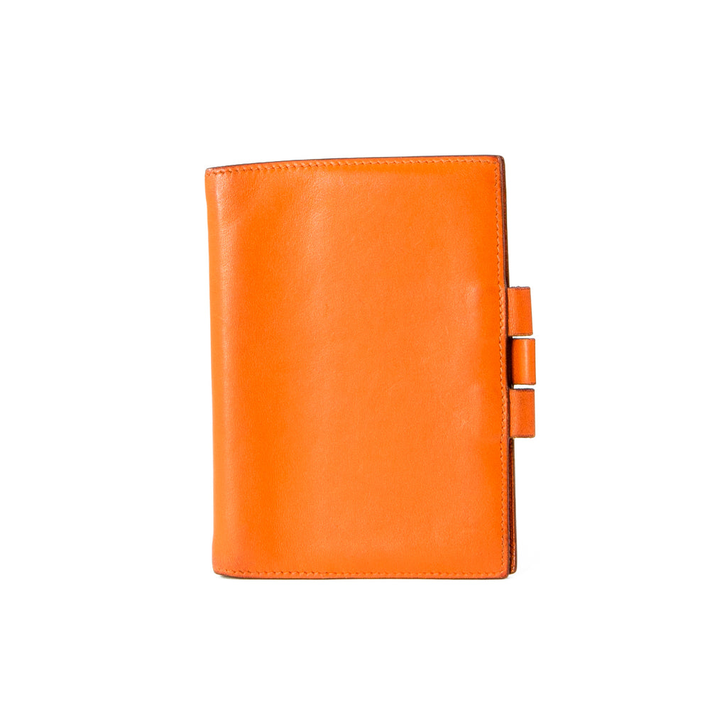 a87c6227189 HERMÈS Orange Tadelakt Leather Vision II Agenda Cover – THEBROWNPAPERBAG
