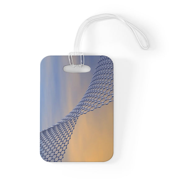 Bag tag featuring a graphene sheet, computerized graphic. Graphene consists of a single layer of carbon atoms arranged in a hexagonal lattice, and has many remarkable properties such as a high strength-to-weight ratio and  electrical conductivity