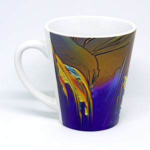 Latte mug featuring crystals of vitamin C (ascorbic acid). Ascorbic acid is an essential vitamin found in fruit and green vegetables and is needed for the growth and maintenance of bones, teeth, skin and blood vessels. It is also a powerful anti-oxidant. Imaged with polarized light microscopy