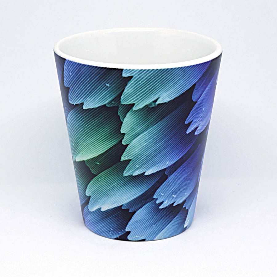 Latte mug featuring scales on the wing of a butterfly. The color of a butterfly wing comes either from a pigment contained in the scales or from iridescence as light is diffracted by the microscopic structure of the scales themselves. The image was made using scanning electron microscopy (SEM)