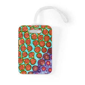 Bag tag featuring multiple single-celled organisms called Paramecium, a type of protozoa that is commonly found in aquatic environments. Imaged with transmission electron microscopy (TEM)