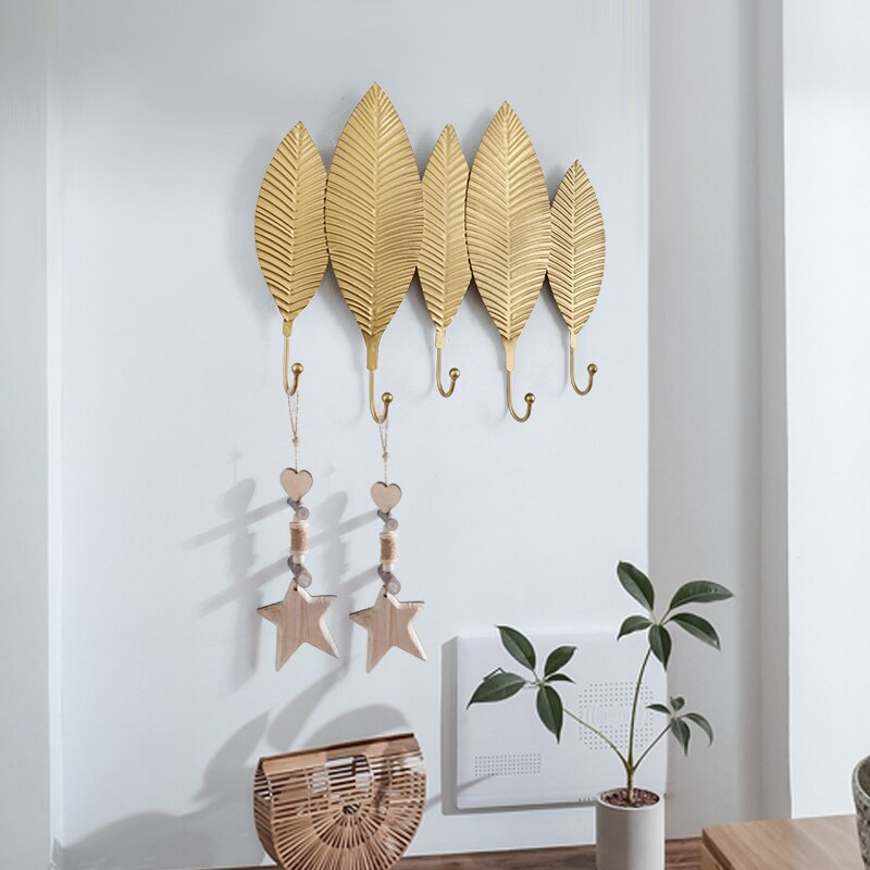 Golden leaf wrought iron hooks - InStyle Walls LLC
