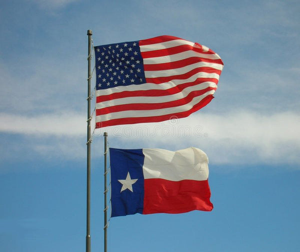 Texas flag flying below US flag