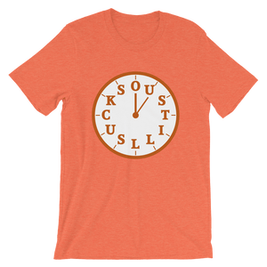 """OU STILL SUCKS"" makes up the numbers of a white clock, on orange shirt"