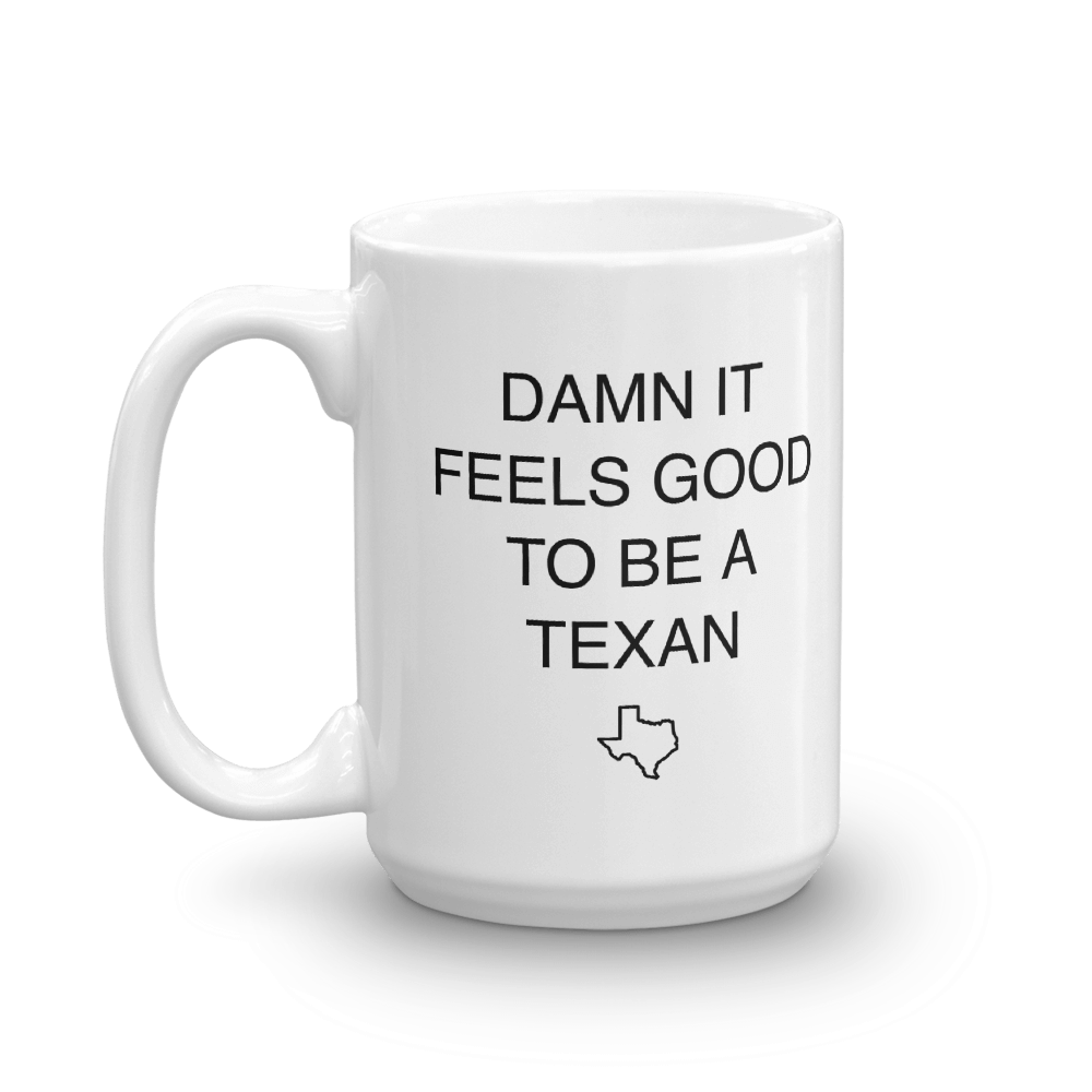 White coffee mug says 'DAMN IT FEELS GOOD TO BE A TEXAN' with Texas outline