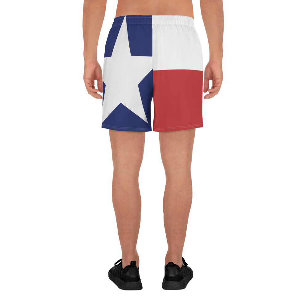 Texas flag pattern shorts on male model below torso, from rear