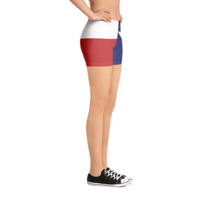 Texas flag pattern shorts on a model below torso, from right