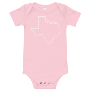 texas shape with 'tiny tex' above it on pink onesie