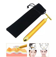 Vibrating gold face massager. With storage bag.