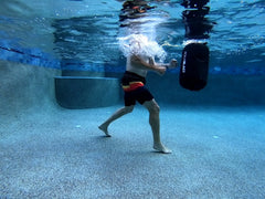 Delivering combination punches to AquaBLAST, the low impact punching bag for swimming pools.