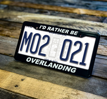 "Load image into Gallery viewer, ""I'd Rather Be Overlanding"" License Plate Frame"