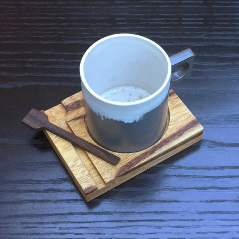 This unique ceramic handmade mug comes with an exotic marblewood coaster and built-in ebony wood stir spoon. Coasters are designed so they also be easily stacked for efficient storage or simply use it as a lid until your ready to enjoy your coffee or favorite hot beverage. Comes in Grey and white and it is dishwasher safe.