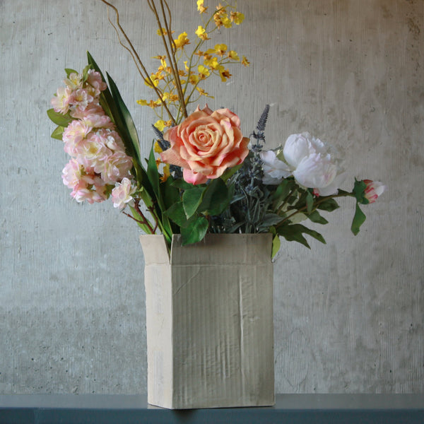 This uniques flower vase is hand cast to resemble a corrugated box with all the details. Use it for fresh or dry flowers. Holds water.
