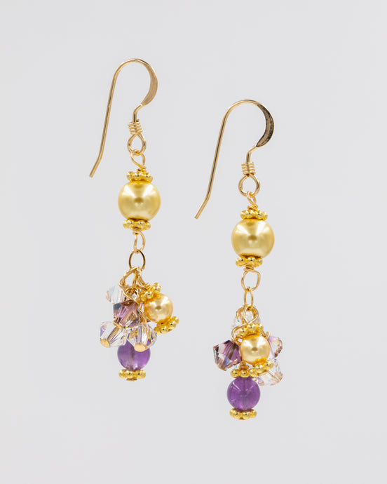 Picture of earrings with amethyst, Swarovski crystal and pearls, and glass pearls