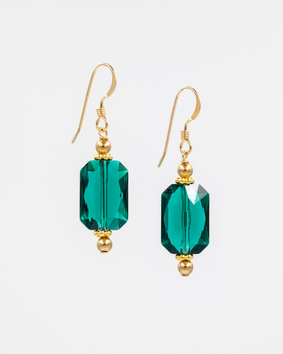Picture of earrings with elongated emerald Swarovski crystal, Swarovski pearls, and gold vermeil