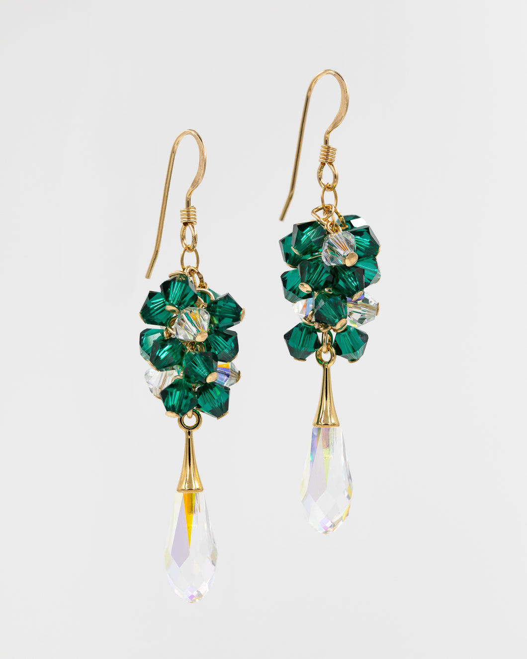 Picture of gold earrings with emerald Swarovski crystals and teardrop