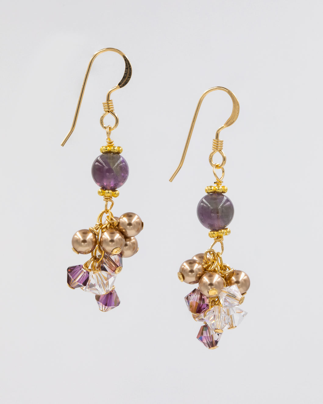 Picture of earrings with amethyst and Swarovski crystal and pearls