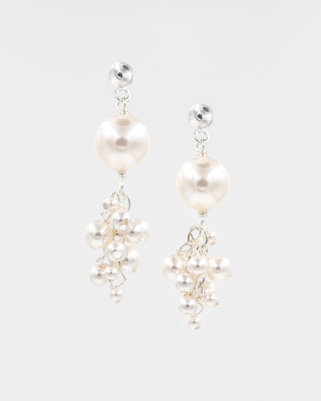 Picture of earrings with clustered Swarovski pearls in white