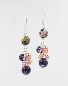Picture of earrings with sunset sodalite and Swarovski crystals and pearls