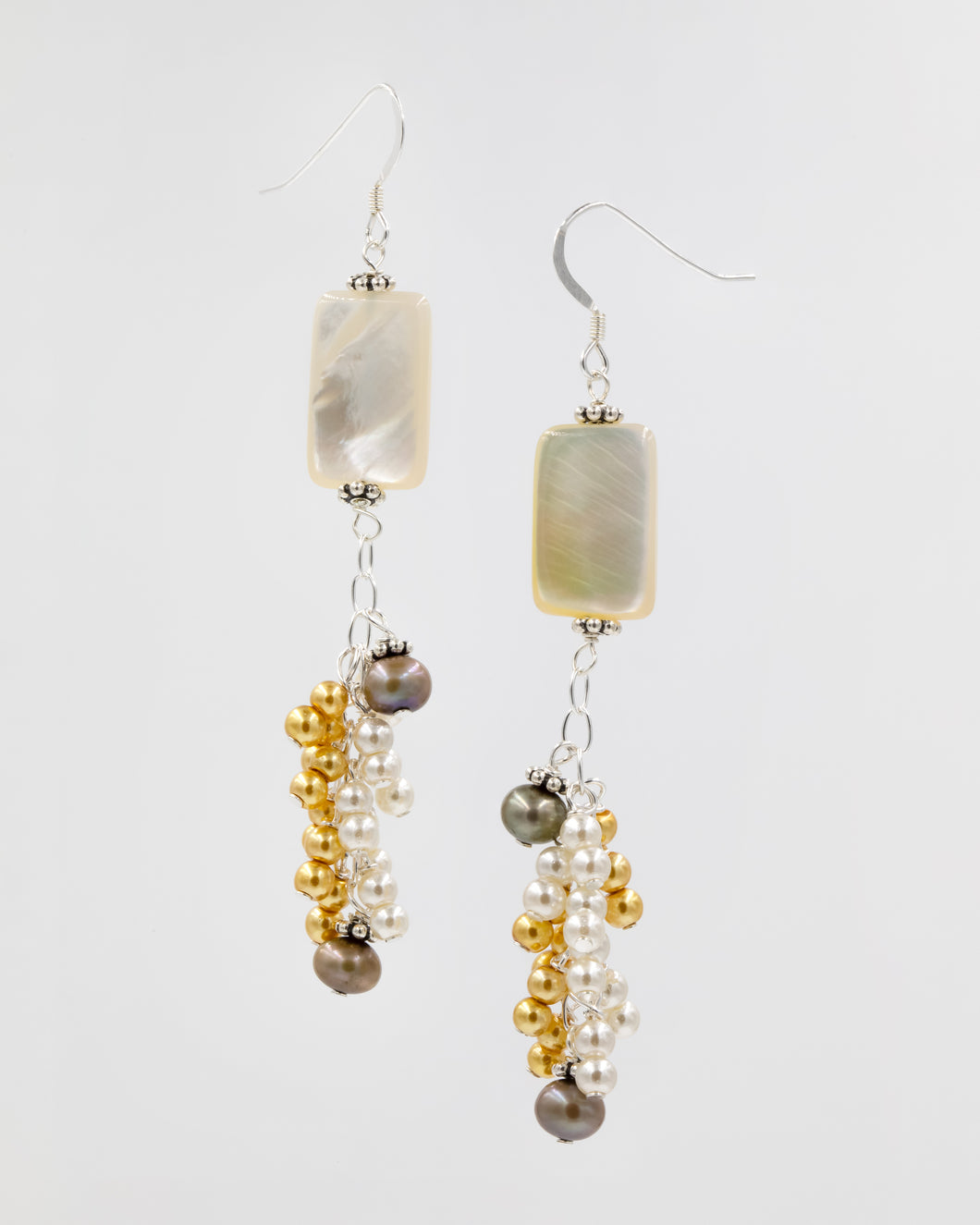 Picture of long earrings with Mother of Pearl, freshwater pearls, and imitation pearls