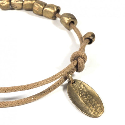 Solid bronze bracelet and waxed cotton cord From Italy