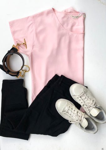 Bare Slumber Pink Pajama Top Paired with Black Jeans, Black Belt and White Sneakers. Very Comfortable and super stylish.