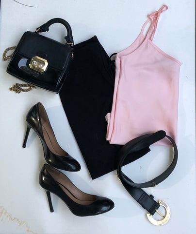 Bare Slumber pajama camisole paired with a black mini skirt, black belt, black heels and black handbag.