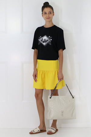 TISSUE MINI PEPLUM SKIRT SUNFLOWER