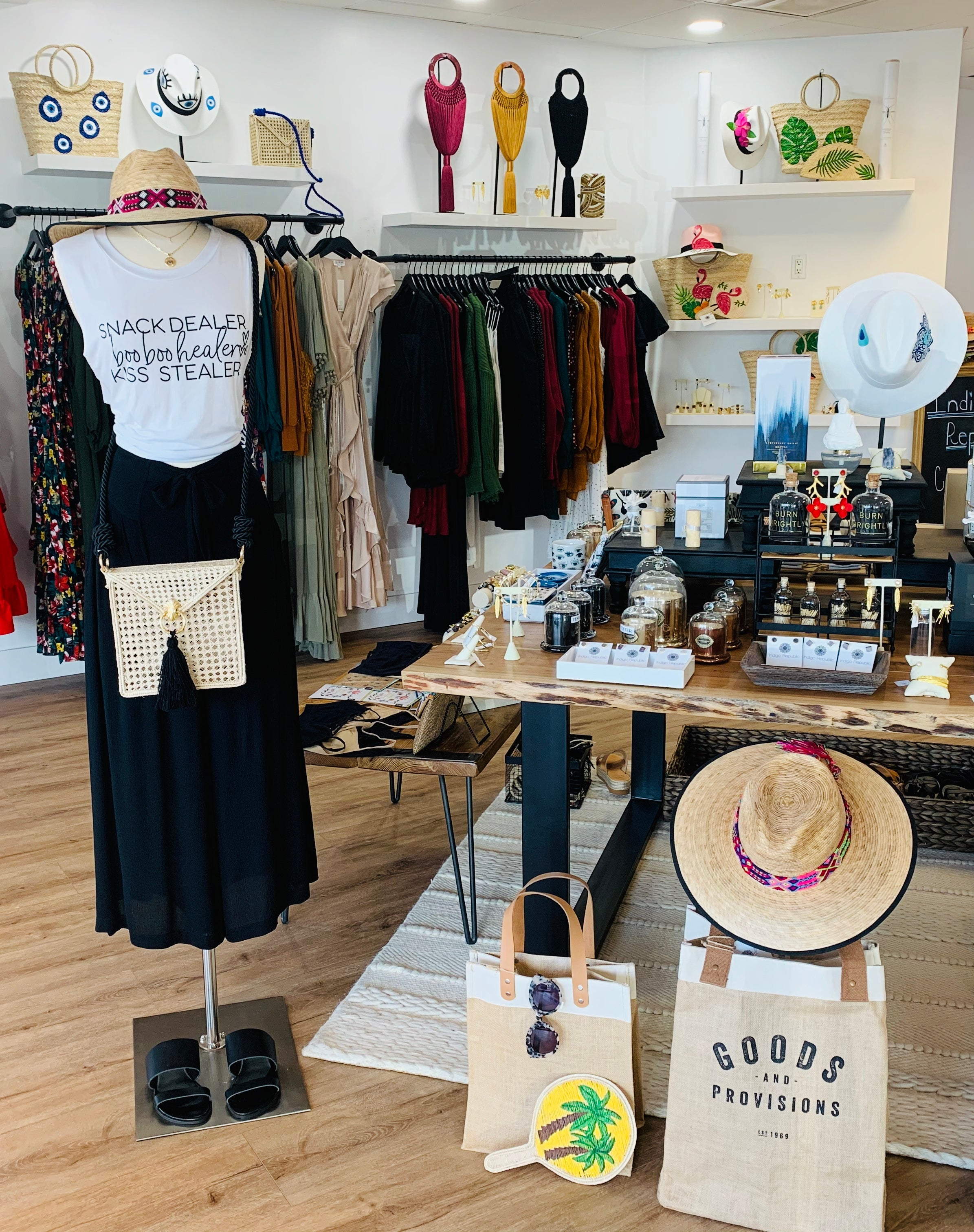 Straw hats, fans, apparel, sunglasses and candles at Indigo Republic Boutique