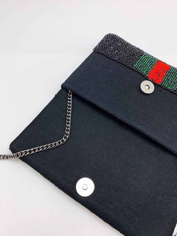 <p>Black Red Green Bee Clutch</p>