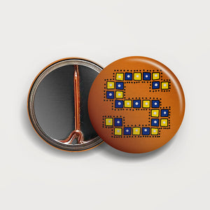 Letter S button badge