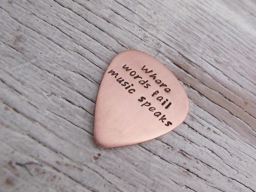 Where Words Fail Music Speaks, Copper Guitar Pick