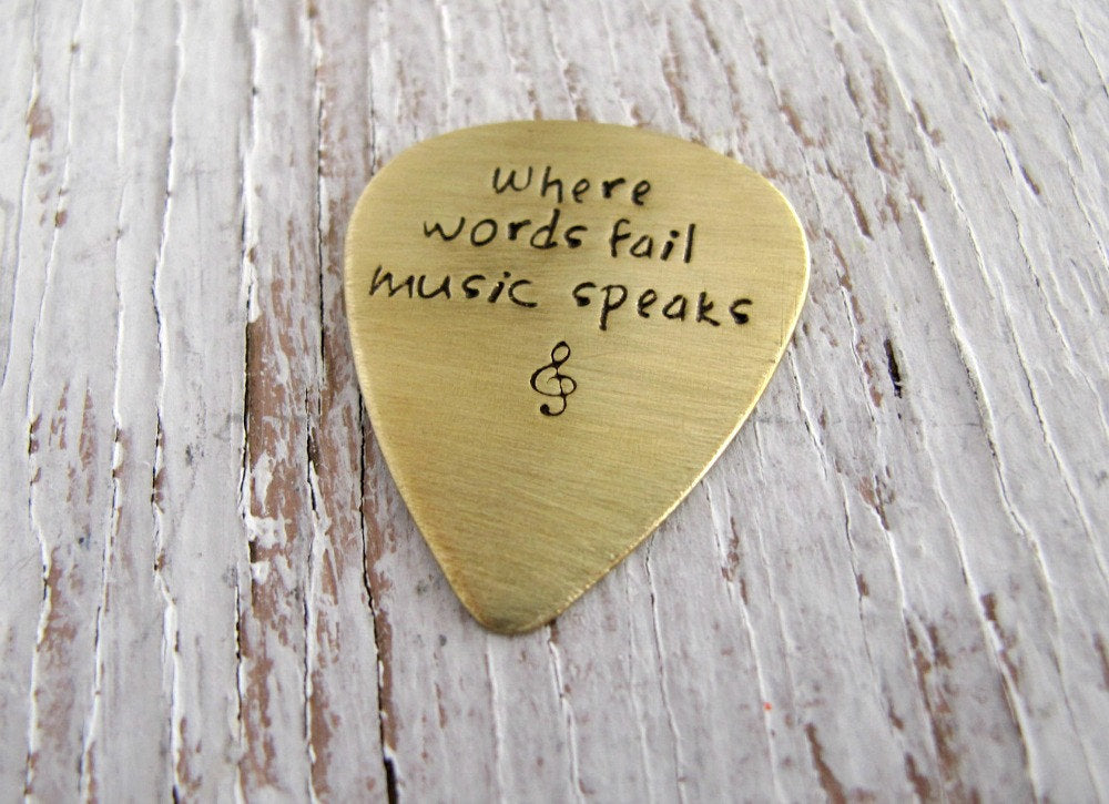 Where Words Fail Music Speaks, Brass Guitar Pick