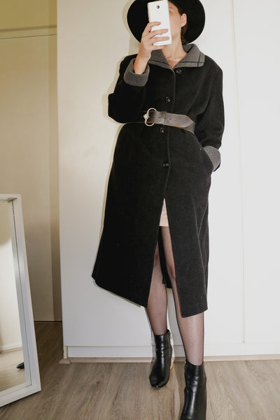 Model wearing long vintage pure wool black coat