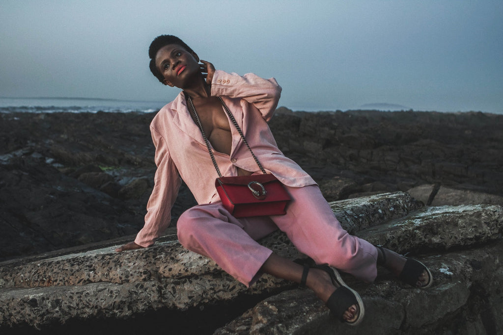 African model wearring pink suit