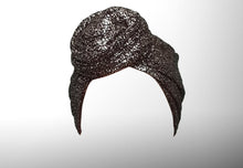 Image is of a wired black silver flake Celine Martine headwrap / hair scarf styled as rosette turban on a white background.