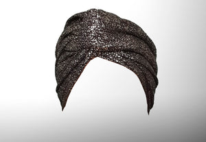 Image is of a wired black silver flake Celine Martine headwrap / hair scarf styled as twisted turban on a white background.