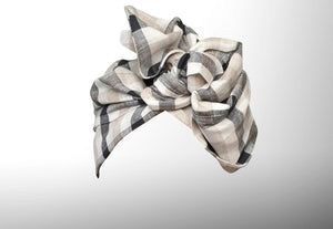 Image is of a natural checked ( white / navy / creme wired Celine Martine headwrap / hair scarf styled as a fanned turban.