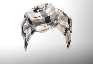 Image is of a natural checked (white/indigo/creme) wired Celine Martine headwrap / hair scarf styled as rosette turban.