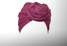 Image is of a wired dark fuchsia Celine Martine headwrap / hair scarf styled as rosette turban.
