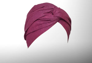 Image is of a dark fuchsia wired Celine Martine headwrap / hair scarf styled as a twisted turban.
