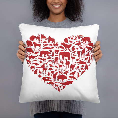 Couch pillow with heart-shaped design made of wildlife animals