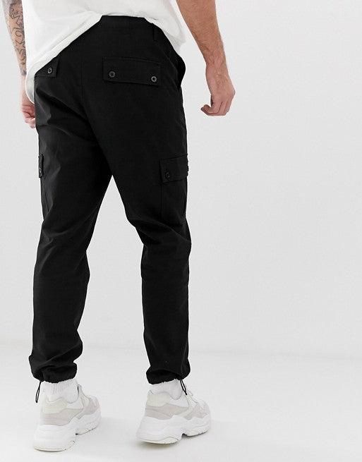 FOS DESIGN tapered cargo trousers in black with toggles